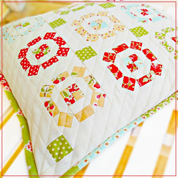 The Rolling Stone Patchwork Pillow is made with assorted vintage inspired fabrics, perfect for bringing hints of spring & summer color to your home decor.