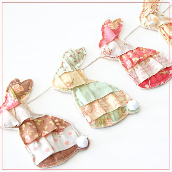 Decorate your home with this adorable Bunny Rabbit Bunting. There are seven bunnies on approximately 9 ft. of string. The bunnies are adjustable. Featuring fabric from Fig Tree Quilts.