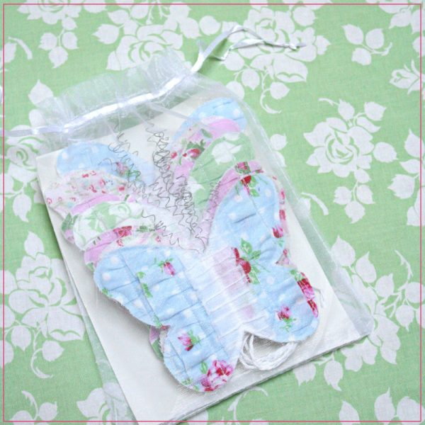 Decorate your home with a shabby chic Butterfly Bunting. There are seven butterflies on approximately 9 ft. of string. The butterflies are adjustable. Featuring fabric from the Delilah collection by Tanya Whelan / Grand Revival Designs for Free Spirit Fabrics.